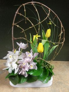 White pinkand yellow tropial flower arrangement for wedding and events