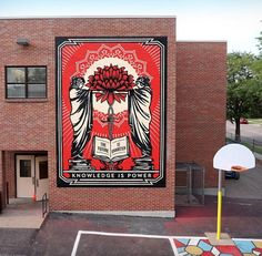 """""""The Future is Unwritten: Knowledge Is Power"""" Mural at Cheltenham Elementary School in Denver, CO - Obey Giant Denver Colorado, Shepard Fairy, The Future Is Unwritten, Pavement Art, Visual Metaphor, School Murals, 3d Street Art, Building Art, Knowledge Is Power"""