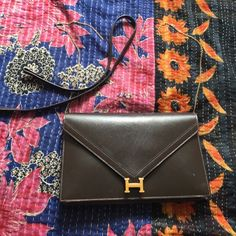 Vintage Hermes clutch with strap. Lydie Vintage Hermes clutch with strap. Strap needs to be repaired. Brown leather and gold hardware. Rare Lydie style, % authentic. One zipped compartment and two other compartments to store things inside the bag has a shoulder strap Hermes Bags Clutches & Wristlets