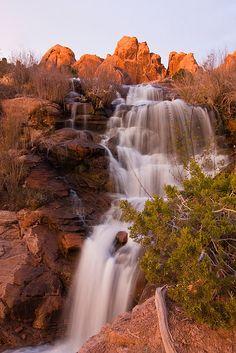 The stunning red cliffs and waterfalls of Faux Falls near Moab, Utah Moab Utah, Utah Hikes, Utah Usa, Utah Vacation, Vacation Spots, Beautiful Waterfalls, Beautiful Landscapes, Places To Travel, Places To See