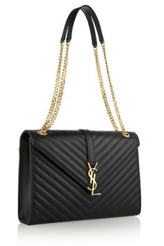 Handbags & Wallets - Black quilted leather (Calf) Convertible chain and leather shoulder strap YSL plaque, back patch pocket, gold hardware Internal zipped pocket Fully lined in black twill Concealed magnetic-fastening front flap Comes with dust bag - How should we combine handbags and wallets?