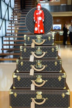Regular Louis Vuitton luggage in the store is now graced with mini Kusamas.