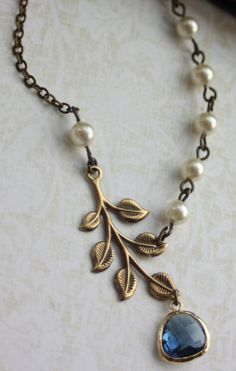 Antiqued Brass Greek Leaf, Gold Plated Montana Blue Glass Drop, Ivory Pearl Necklace.