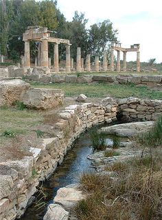 The sanctuary at Brauron consists of a small temple, a unique stone bridge, sacred caves, a spring, and a pi shaped stoa for feasting. It was used until the 3rd century BC when tensions increased between Athens and Macedon and the unfortified sanctuary was abandoned.
