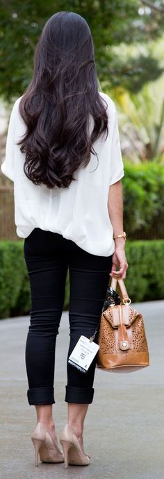 Black pant, white blouse and brown bag