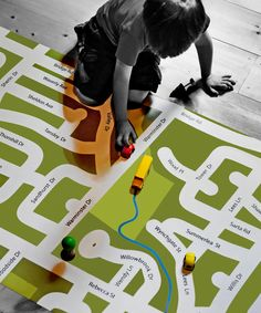 Learn local streets in the neighborhood while driving toy cars on this custom-designed road map play mat.