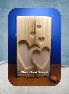 double hearts with hearts book folding pattern by BlushBookDesign on Etsy Any Book, Love Book, Unique Christmas Decorations, Hearts And Roses, Book Folding Patterns, Folded Book Art, Pattern Art, New Books, Unique Gifts