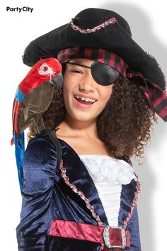 They're ready for a daring voyage across the seven seas in a Light-Up Sparkle Pirate Costume for kids. The highly detailed dress looks like a blue velour coat belted over a white ruffled pirate shirt and a black and burgundy striped skirt with gauze details. Top off their pirate captain look with a tricorn hat with an attached scarf and silver trim. Eye patch and parrot not included. Pirate Costume Kids, Halloween Costumes, Pirate Shirts, Kids Lighting, Blue Coats, Stripe Skirt, Seas, Light Up, Parrot