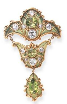 A FINE ART NOUVEAU PERIDOT, DIAMOND AND ENAMEL BROOCH, BY MARCUS & CO.  Designed as a green plique-à-jour enamel plaque, centering upon an oval-cut peridot, enhanced by old European-cut diamond collet and textured gold trim, suspending a smaller plaque of similar design, to the drop-shaped pendant, set with a pear-shaped peridot and textured gold scroll motifs, mounted in gold, circa 1900 Signed Marcus & Co.
