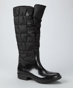 Treat feet to cozy warmth on rainy days. These quilted rain boots feature snuggly soft lining and a waterproof saddle style, while a strong lace-up closure ensures a perfect fit.