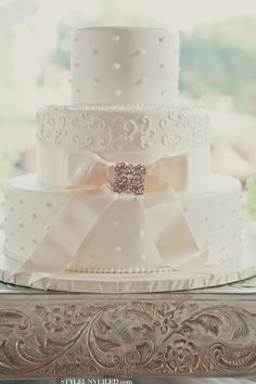 Pretty White Cake with a Dazzling Pink Bow www.STYLEUNVEILED.com