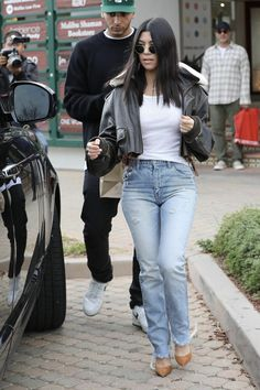 Kourtney Kardashian wearing Gianvito Rossi Suede Pumps, Moussy Mv Waist Fit Straight Jeans and Sami Miro Vintage 1/1 Smv Brown Leather Shearling Flight Jacket