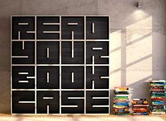 ABC bookshelf by Eva Alessandrini and Roberto Saporiti for Saporiti (r)  the ABC bookshelf is an innovative modular storage system made up of individual cubes, which permit to create words with shelves to store books. All letters and numbers are available in 11 different colours