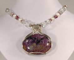 Russian Charoite wrapped in Sterling Silver. Sculptured by Tina Louise