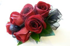 Red rose corsage.