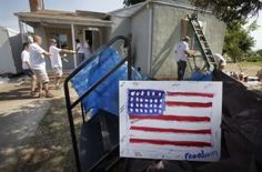 To celebrate Independence Day, Sears Heroes at Home and Rebuilding Together volunteers revitalize the home of U.S Navy veteran Kenny Aguirre.