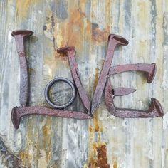 Railroad spike art, love word art, railroad spike word, love wall hanging, love shelf art, metal art, weld art, rustic wedding decor, hand forged railroad spikes, scrap metal art