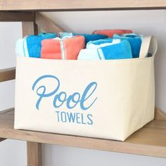 A Southern Bucket Stack your pool towels in this stylish extra large canvas storage bin, featuring charming typography in caribbean blue. Beach Towel Storage, Towel Rack Pool, Pool Storage, Pool Towels, Towel Racks, Closet Storage, Diy Storage, Storage Ideas, Fabric Storage Bins