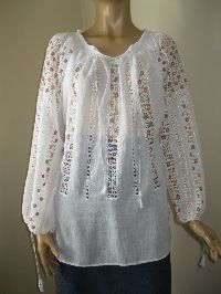 Tinny flowers in lace on a romantic gorgeous Romanian peasant blouse available at www.greatblouses.com .