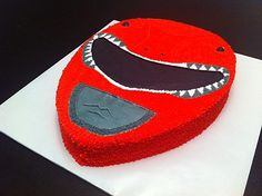 Darrick contacted us a fewmonths back about doing a red Power Ranger birthday cake for his son. He wanted a vanilla cake with buttercream icing to feed 20. We began by baking a 11×15 sheet cake a…