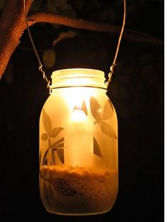 Frosted glass spray gives these easy leaf-themed lanterns an even more romantic ambience.