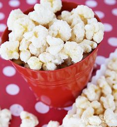 White chocolate popcorn- the perfect holiday gift for neighbors, co-workers, and friends. Super easy and fast gift idea. #recipe #gift #idea skiptomylou.org