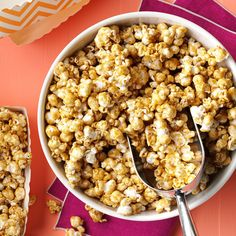 Courtside Caramel Corn Recipe -My guests say they can't stop eating my caramel corn! For our basketball party I fix enough to fill a big red tin with our team's logo. The delectable syrup coats the popcorn well but isn't sticky. —Sharon Landeen, Tucson, Arizona