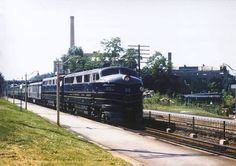 An A-B set of Baltimore & Ohio F3's have a heavyweight passenger consist during a summer's day in the 1950s.  Possibly Willard, OH