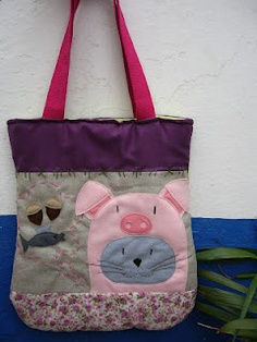 """Once upon a time there was a cat who thought it was a pig so it ate sardines and acorns and made """"Mioinc mioinc ..."""". Fabric bag with interior linning and pocket."""