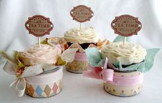 A sweet way to display cupcakes. Nestled in tin boxes with other adornments added...