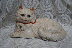 Hubley Cast Iron Reclining White Persian Cat Door Stop Blue Eyes Pink Ears by FolkloreAndYore on Etsy