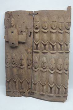 Antique West African Dogon Granary door in wood construction. Having two rows of Nommo figures. Lock is also comprised of Nommo figure.