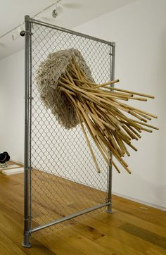 Michael DeLucia Untitled(fence with mops), 2007