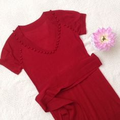 Sweet red dress Only worn once!  Deep red sweater dress.  Super lightweight, Delicate and flirty v-neck. Has tie belt and belt loops. I removed tag, but I think brand Banana Republic. Would best fit size 2/4.  70% acrylic/30% wool. Has a small blemish (microscopic hole) in front chest and upper back. Not very noticeable at all (doesn't show up in the close up 4th pic). Banana Republic Dresses