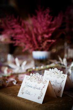 Pretty lace seating cards, photo by Asya Photography | junebugweddings.com