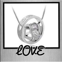 18K plated heart necklace Show your love with this 18K plated heart and ring necklace.  Heart engraved ring and Austrian Crystal element embellished heart can be worn together or separately on chain.NEW Jewelry Necklaces