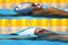 Sebastian Stoss of Austria and Derya Buyukuncu of Turkey compete in heat 1 of the Men's backstroke on Day 5 of the London 2012 Olympic Games at the Aquatics Centre, August (Clive Rose/Getty Images) Olympic Swimming, Swimming Diving, Great Pictures, Cool Photos, Interesting Photos, Swimming Pictures, 2012 Summer Olympics, London Summer, Olympic Athletes