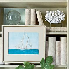 How-to Beautify Your Bookcase | Add some art. | CoastalLiving.com