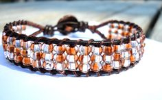 I just bought one and can't wait to wear it with... pretty much everything. :) Toasted Caramel Bracelet by shiningstones on Etsy. $32.00 USD, via Etsy.