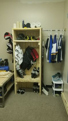 Locker style rack for drying hockey gear with coat hangers for jerseys Hockey Room, Hockey Gear, Hockey Coach, Hockey Stuff, Sports Locker, Diy Locker, Sports Equipment Storage, Home Made Gym, Hockey Crafts
