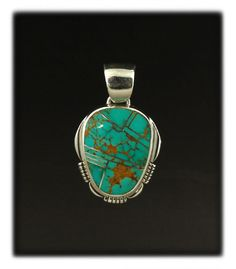 Sterling Silver Pendant with Inlaid Turquoise
