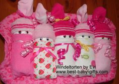 Girl diaper babies in a box (this diaper gift consists of 3 pairs of socks, 5 washcloths, 20 diapers and a pink storage box for baby stuff), instructions here: http://www.best-baby-gifts.com/diaper-babies.html