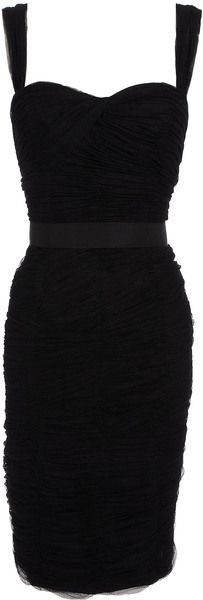 DOLCE & GABBANA  Tulle Corseted Dress  Black tulle corseted dress. The tulle straps lead into twist front bust. The lining is corseted. The tulle sits in horizontal pleats. A grosgrain ribbon defines the high waist. An exposed zip fastening runs down the back of the dress. The hemline falls below the knee.