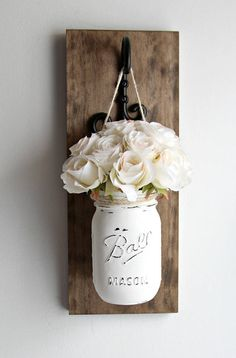 This listing is for 1 SET of 2 rustic mason jars wall sconces. These wall sconces are a great addition to your rustic home decor ! These sets are perfect for any wall in your home, sure to add color to your office, kitchen or living room. Each sconce includes : black decorative hanger, 1