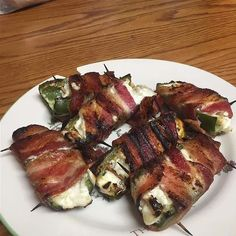 Step 1   Preheat an outdoor grill for high heat.  Step 2   Spread cream cheese to fill jalapeno halves. Wrap with bacon. Secure with a toothpick.  Step 3   Place on the grill, and cook until bacon is crispy Cream Cheese Recipes, Cream Cheeses, Yummy Appetizers, Appetizers For Party, Stuffed Jalapenos With Bacon, Stuffed Peppers, Taco Seasoning, Fill, Pork