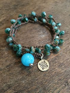 Beautiful Tahitian blue/turquoise multi faceted Czech beads are crocheted onto dark brown cord accenting the luxurious color of these beautiful