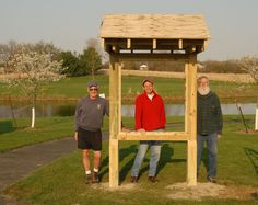 Bob Daniels, Dennis Gordon and Dave Johnson with the new outdoor bulletin board at Leohr Park.