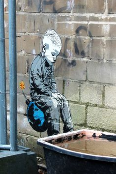 Boy on Bomb by Berlin based stencil Street Artist Alias