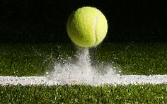 A tennis ball bouncing off of a baseline