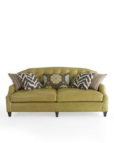 Olive green leather tufted sofa